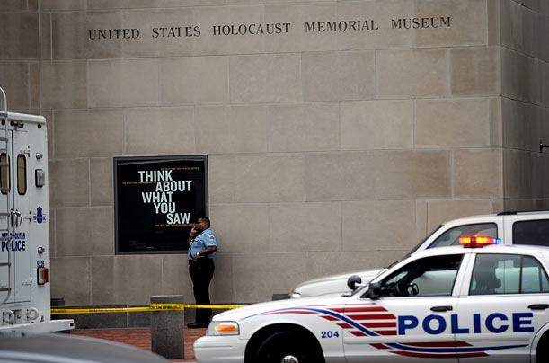 A Washington, DC police officer stands outside the U.S. Holocaust Museum, a day after a white supremacist killed a security guard there.
