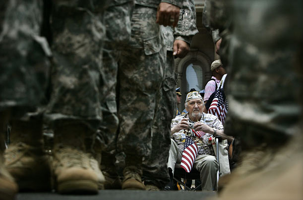Pearl Harbor survivor James J. Hewitt watches as hundreds of New Jersey National Guard soldiers march in Trenton, New Jersey