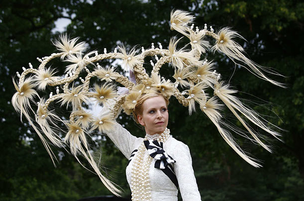 A woman shows off her hat made by Louis Mariette during the third day of England's Royal Ascot horse race.
