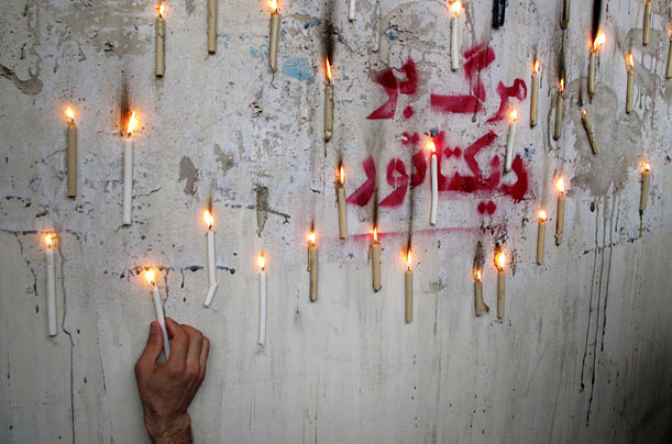 Supporters of defeated Iranian presidential candidate Mir-Hossein Mousavi use candles to protest the election.