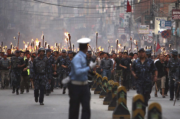 Maoist activists take part in a rally in Kathmandu, Nepal to demand the removal of army chief General Rookmangud Katawal.