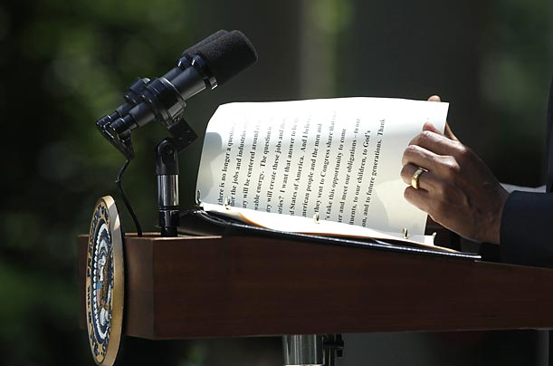 President Obama turns to the last page of his notes during remarks on a new energy bill presently before Congress.
