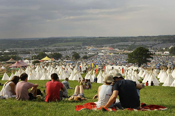 Festival-goers enjoy sunshine at the Glastonbury Festival in Somerset, England.
