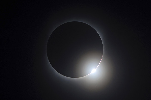 The moon passes between the sun and the earth during a solar eclipse as seen in Changsha, Hunan province July 22, 2009.