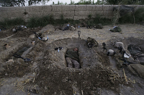 U.S. Marines sleep in their foxholes in Afghanistan's Helmand Province.