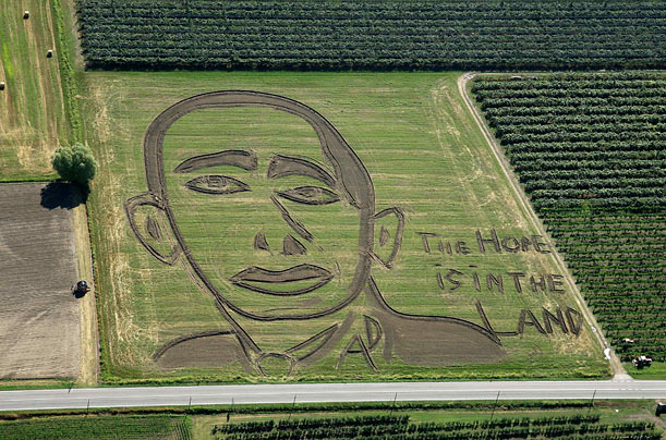 A giant portrait by Italian artist Dario Gambarin of US President Barack Obama appears in the countryside of Mena' di Castagnaro, Italy.