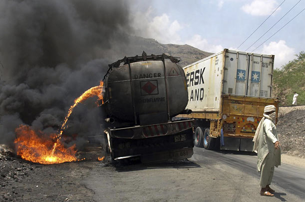 Militants fired a rocket-propelled grenade at a truck carrying fuel for Coalition forces in Afghanistan, killing the driver.
