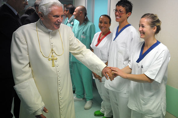 Pope Benedict XVI shakes hands with the medical team of Aosta's Umberto Parini hospital which cared for him after he broke