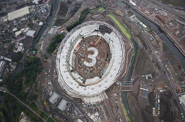 Olympic Stadium workers in London outlined a giant number three to signify that three years remain until the 2012 Games.