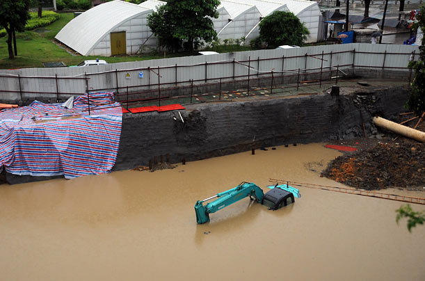 A construction site in Liuzhou City, China sits under large floodwaters.