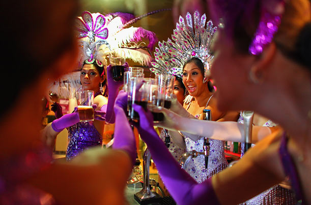 The Lady Boys of Bangkok have a drink in a pub ahead of their appearance in the Edinburgh Festival Fringe.