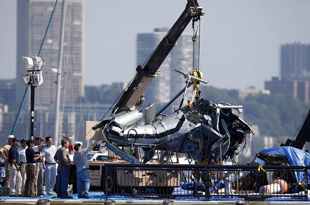 The wreckage of a helicopter that collided with an airplane and crashed in the Hudson River is positioned on a pier in Hoboken,