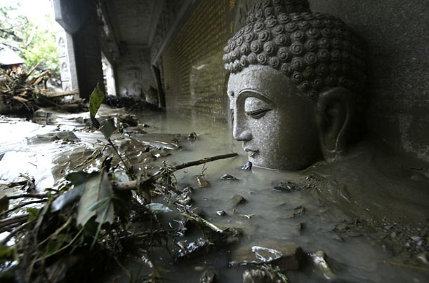 A statue of Buddha sits chin deep in flood water and debris at a temple in southern Taiwan. Typhoon Morakot flooded the island with 83 inches of rain on Aug. 7 and 8.