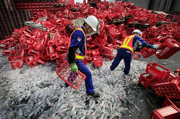 Sapporo beer factory workers clean up broken bottles after a 6.5-magnitude earthquake in Shizuoka, Japan.