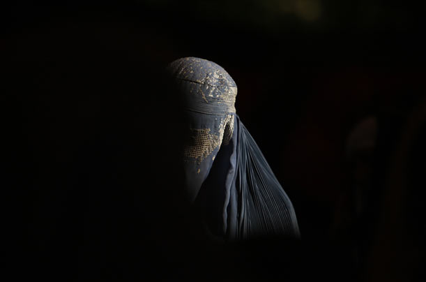 A woman listens to presidential candidate Ashraf Ghani Ahmadzai at a rally in Kabul, Afghanistan.