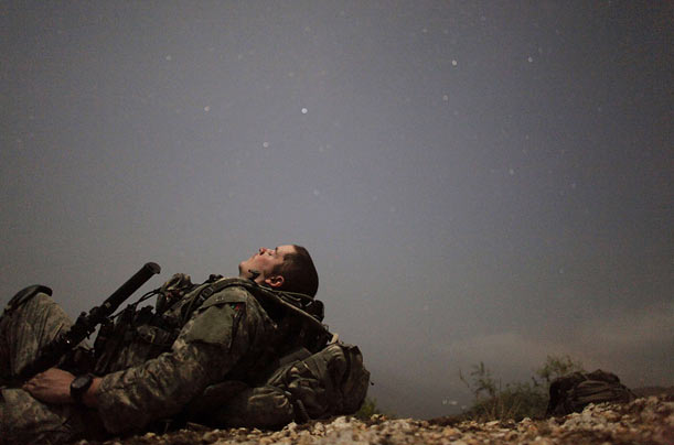 A U.S. soldier takes a break during a night mission in Kunar Province of Afghanistan.