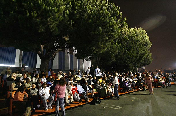 People wait to receive free medical treatment during the Remote Area Medical health clinic in Inglewood, California.