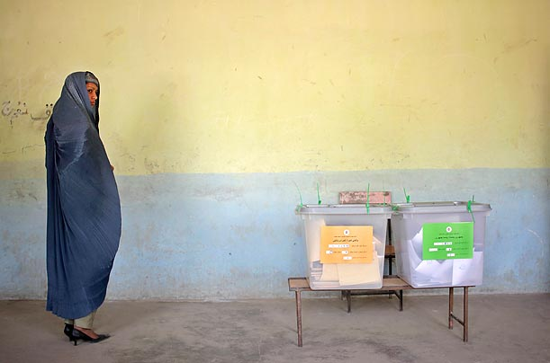 An Afghan woman waits to cast her ballot for the presidential election at a polling station in a Kabul mosque.