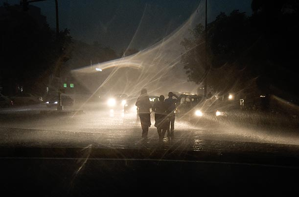 Commuters are caught in a sudden thunder storm in New Delhi.