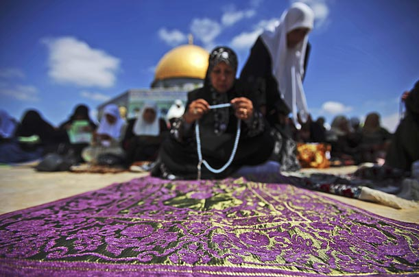 In Jerusalem's Old City, Muslim women pray during the first Friday prayers of the holy month of Ramadan, where observants fast from dawn till dusk.
