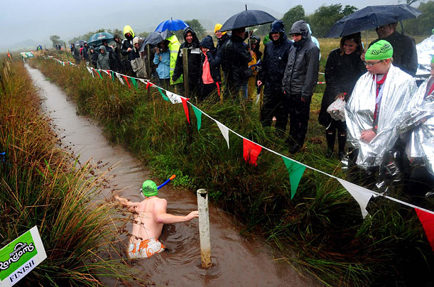 Crowds appear despite the rain to watch the annual World Bog Snorkeling Championship in Llanwrtyd Wells, Wales.