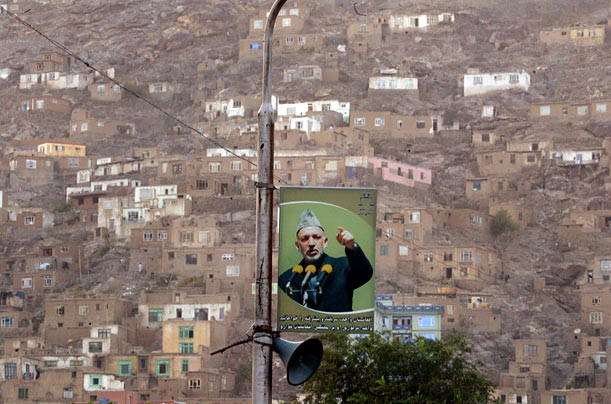 A picture of Afghan incumbent President Hamid Karzai hangs from a post in Kabul, as doubt grows around the world about the legitimacy of his recent victory.