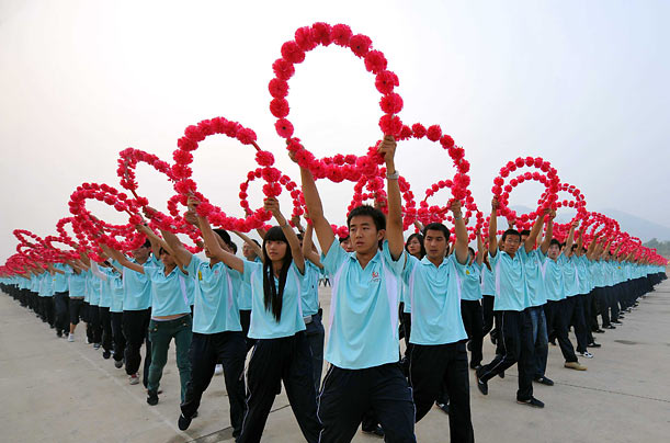 Performers in Beijing rehearse for the upcoming celebration on the 60th anniversary of the Chinese Communist Revolution.