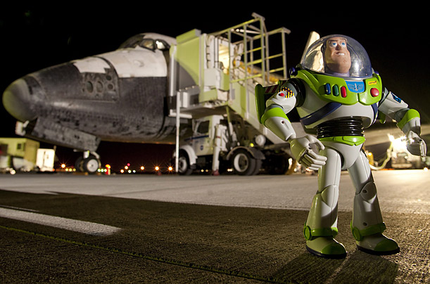 Buzz Lightyear returns to Earth aboard space shuttle Discovery, after spending 15 months aboard the International Space Station.