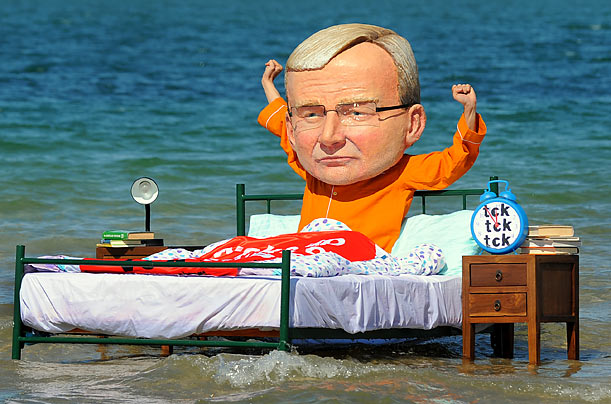 A protester in Melbourne dressed as a caricature of Australian Prime Minister Kevin Rudd encourages the leader to wake up to the urgency