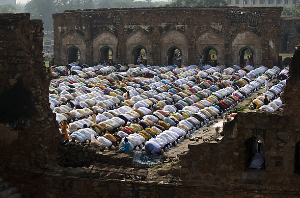 Indian Muslims celebrate Eid al-Fitr, the festival which marks the end of Ramadan at a mosque in the ruins of the Ferozshah Kotla Fort in New Delhi.