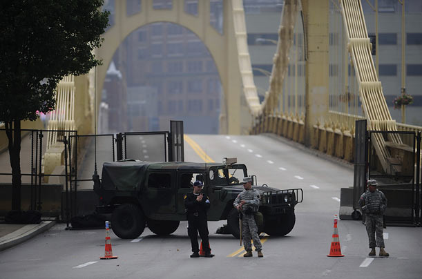 Armed guards man the 9th Street Bridge in Pittsburgh as members of the G20 arrive to discuss the environment, education, health care, and economics.