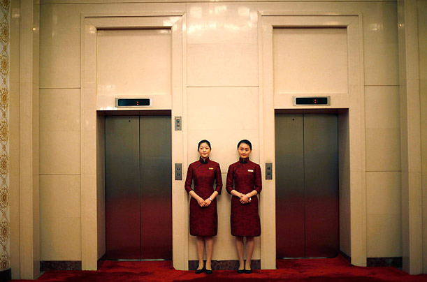Chinese attendants stand outside the hall where U.S. Deputy Secretary of State James Steinberg speaks with Chinese Vice Minister Xi JinPing during their meeting at Great Hall of the People.