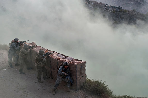 A combined team of Army soldiers and Marines provides covering fire during a mission near the village of Laui Kalay in the remote Korengal Valley, Kunar Province, Afghanistan.