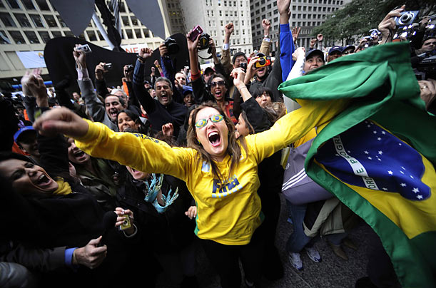 Brazilians celebrate in downtown Chicago as the International Olympic Committee chooses Rio de Janeiro as the host city for the 2016 Olympic games.