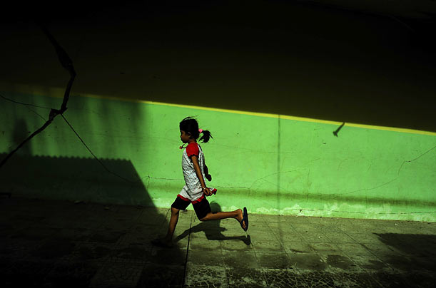A girl runs through the Timbalun Primary School Number 2 in a village on the outskirts of the earthquake-hit city of Padang, Indonesia.