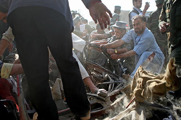 Rescue workers attempt to recover a body at the scene of a Taliban suicide bombing that authorities say targeted the Indian embassy in Kabul.
