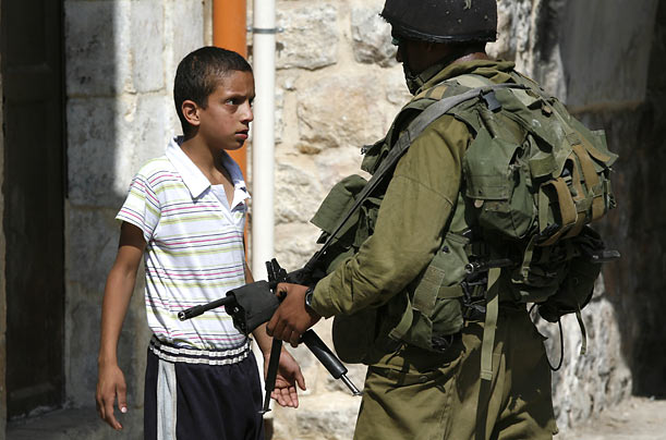 A Palestinian boy confronts an Israeli soldier following a demonstration in the West Bank city of Hebron.