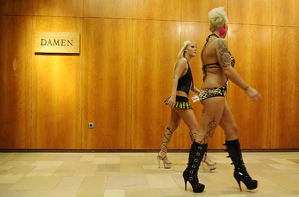 Erotic performers make their way to a show during the Venus erotic fair in Berlin.