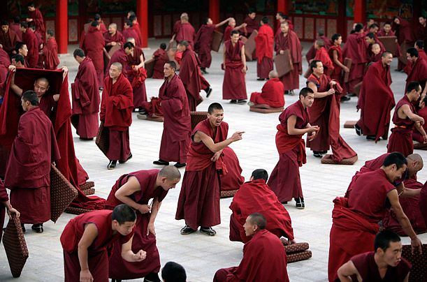 Tibetan monks attend a Buddhist lecture at Longwu monastery in Tongren, Qinghai province.