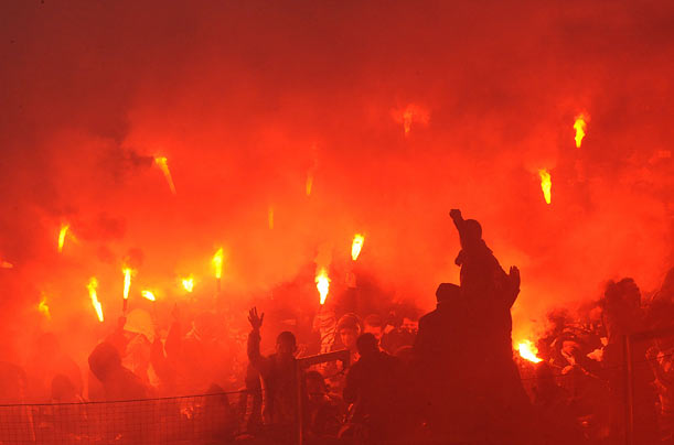 Supporters of Istanbul's soccer team light flares during a Champions League group stage match between Germany's VfL