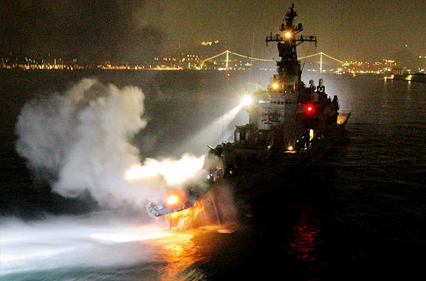 Fire and smoke spew from the bow of the Japanese Maritime Self-Defense Force destroyer Kurama after colliding with a South Korean container ship in the Kammon Straits off Japan.