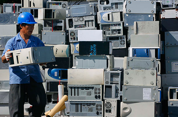 A man arranges discarded computers at one of Taiwan's largest recycling factories in Taoyuan county.