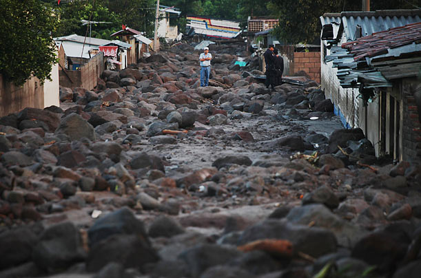 Flooding in Verapaz, El Salvador buried this street in rocks and killed at least 124 people across the country.