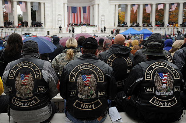 Veterans wait to hear President Obama speak at the Memorial Amphitheater at Arlington National Cemetery in Virginia.
