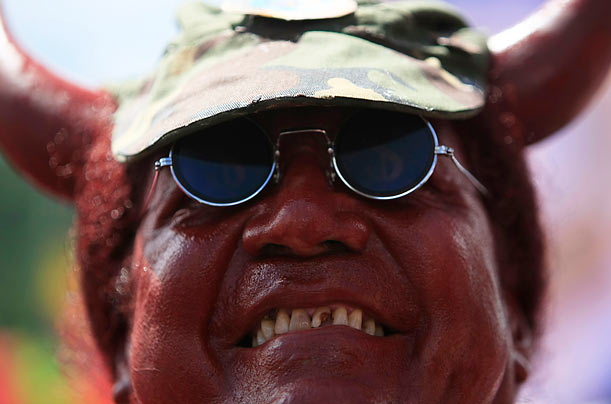 A supporter of Venezuela's President Hugo Chavez in a devil costume protests an agreement that allows the U.S. to expand its military presence
