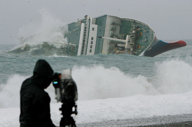 The commercial ferry Ariake lists to starboard in a storm off the coast of Kumano city in Japan. Passengers and crew members were rescued by the coast guard.