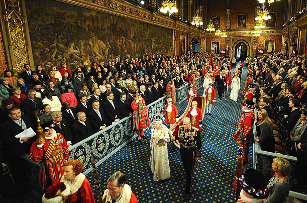 Britain's Queen Elizabeth II and Prince Philip walk through the Royal Gallery in the Houses of Parliament in London, during the annual State Opening of Parliament.