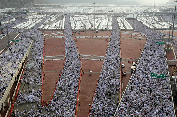 Muslims on their way to throw pebbles at a stone pillar representing the devil, during the Hajj pilgrimage in Mina near Mecca.