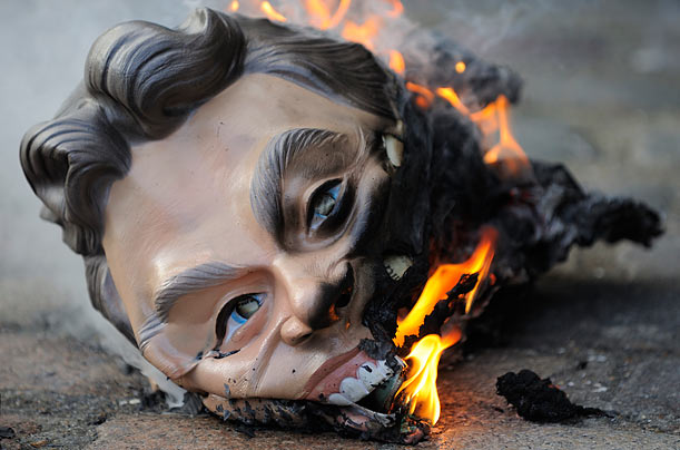 A mask representing former British Prime Minister Tony Blair burns in London on the fifth day of the inquiry into England's role in the Iraq war.