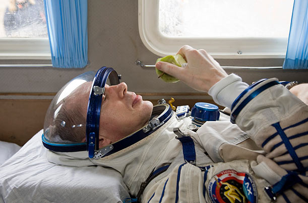 European Space Agency astronaut Frank De Winne of Belgium enjoys an apple after returning from space. The capsule containing him